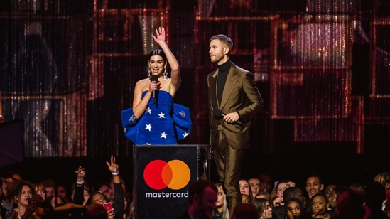 Dua Lipa and Calvin Harris accepting their BRIT Award
