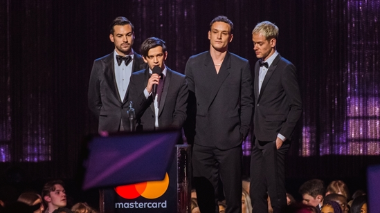 The 1975 accepting their BRIT Award