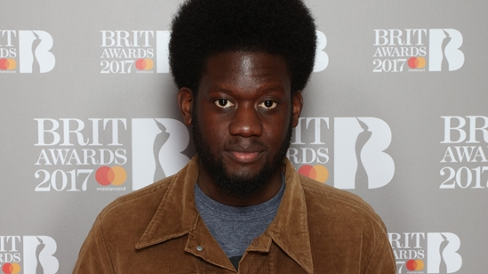 Michael Kiwanuka on The BRITs 2017 Nominations Show Red Carpet.