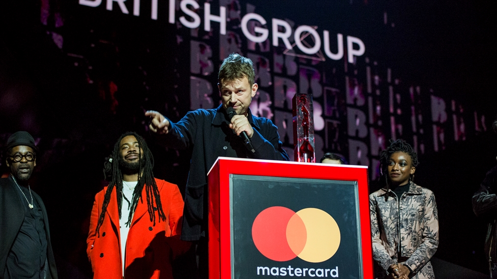 Gorillaz accepting their award for British Group  at The BRITs