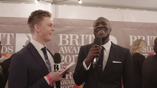 Caspar Lee and Stormzy on The BRITs Red Carpet