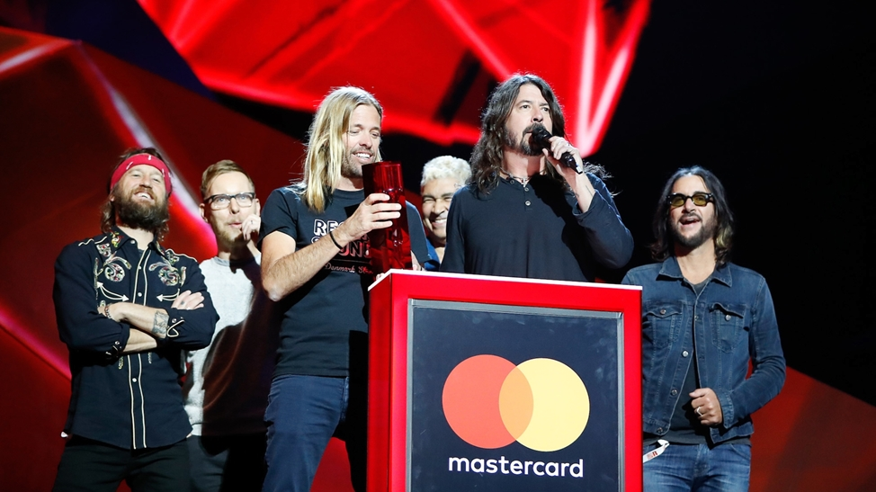 Foo Fighters accepting their award for International Group at The BRITs