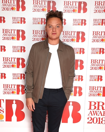 Conor Maynard on The BRITs 2018 Nominations Show Red Carpet.