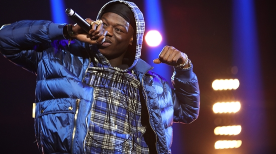 J Hus on stage at The BRITs2018 Nominations Show
