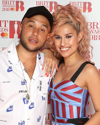 Jax Jones joins Raye on The BRITs 2018 Nominations Show Red Carpet.