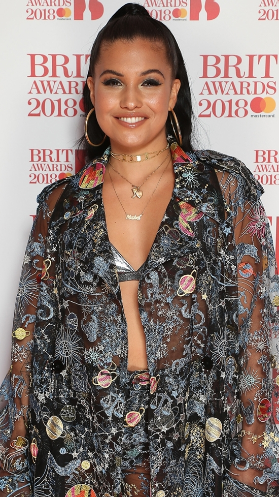 Mabel on The BRITs 2018 Nominations Show Red Carpet.