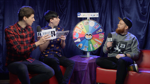 Jack Garratt spinning the 'Wheel of Wonder' with Dan and Phil