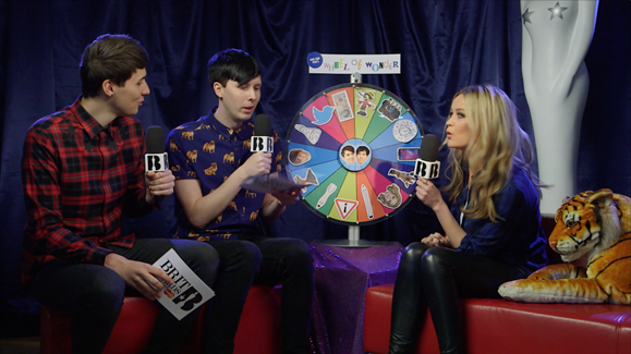 Laura Whitmore spins the 'Wheel of Wonder' whilst backstage at the BRITs Launch with Dan & Phil