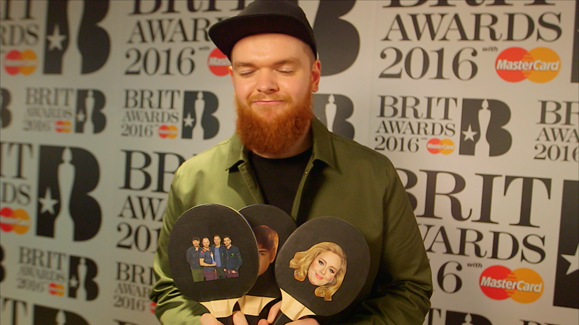 Jack Garratt playing a game of 'Adele, Bieber or Coldplay' on the BRITs launch red carpet