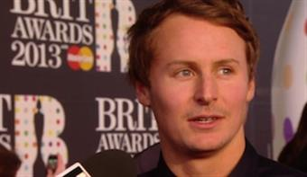 Ben Howard stops to chat with Rizzle Kicks on the 2013 red carpet