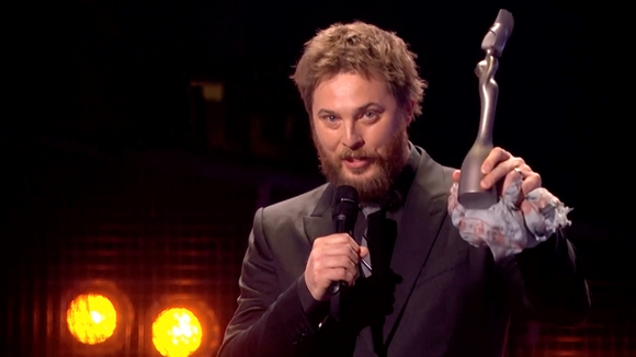 Duncan Jones collects Bowie's Mastercard British Album trophy