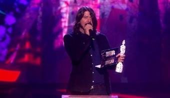 Dave Grohl accepts award for International Group on behalf of Black Keys